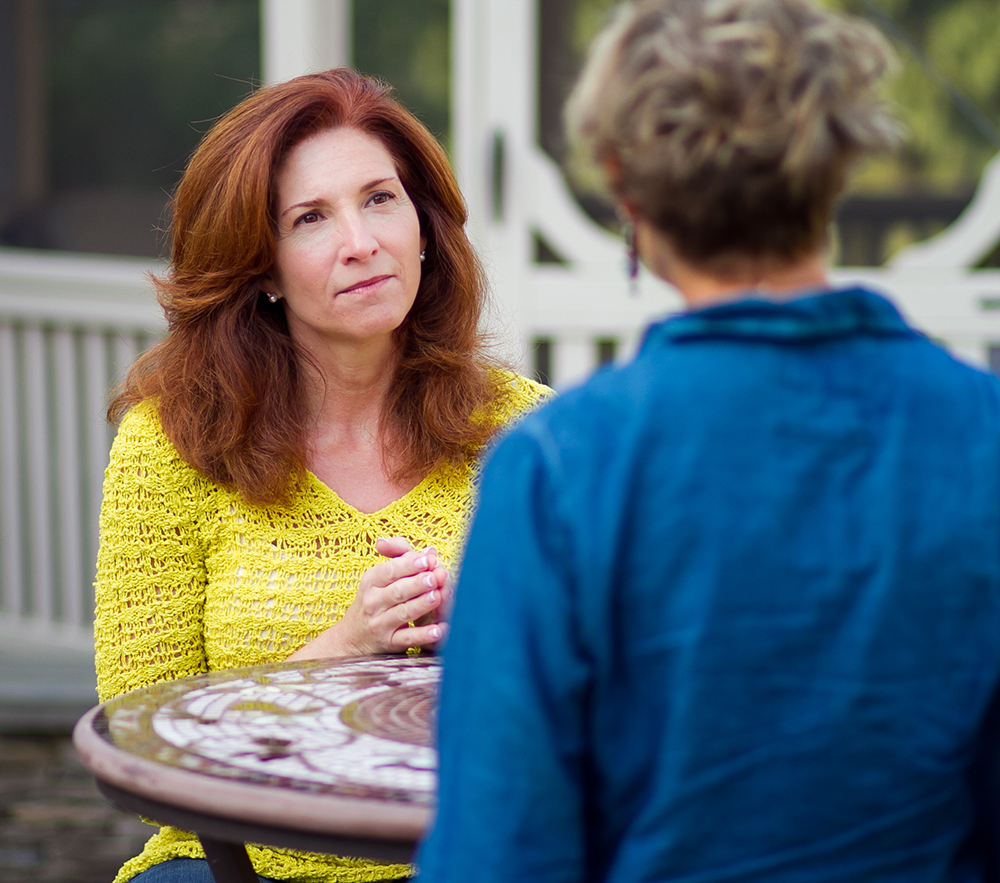 Kimberley Bell, life coach, listening intently to client